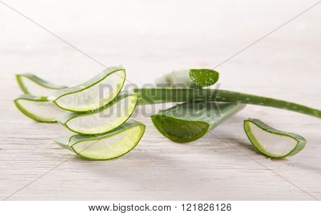 Aloe Vera leaves on wooden background, close-up.