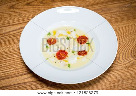 Cod On Mashed Potatoes And Tomato Confit