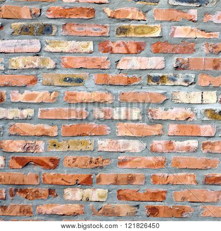 A Grungy Red Brick Wall Texture, Background.
