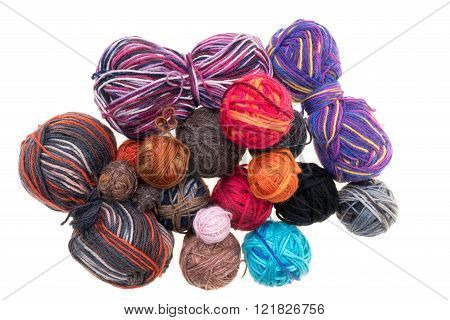 Different Colored Balls Of Wool On A White Background
