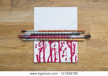 Bloody Blots Of Ink With Different Brushes On A White Paper
