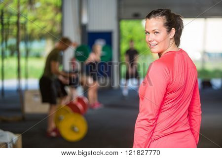 Fit Woman Smiling At Box