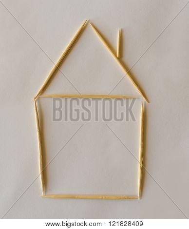 Tiny house model made of bamboo toothpicks.