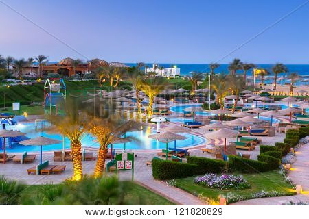 HURGHADA , EGYPT - APR 9, 2013: Three Corners Sunny Beach Resort in Hurghada at night. Three Corners is Belgian company with 11 hotels at Red Sea in Egypt and one in Budapest - Hungary.