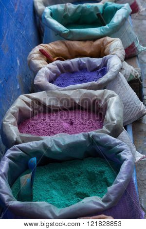 powdered paint pigments in the market of Chefchaouen, Morocco
