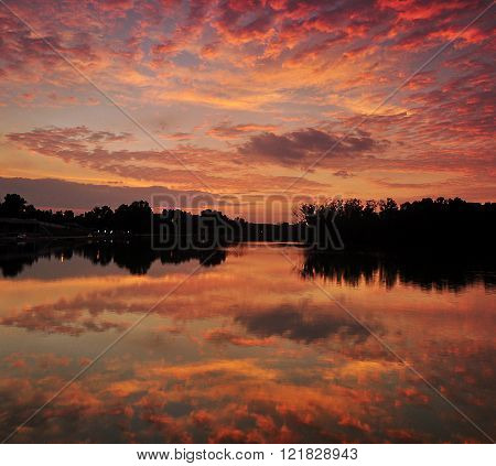 Dramatic Sunset Sky With Reflections.