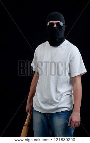 Young hooligan on dark background on dark background