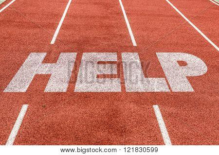Help written on running track