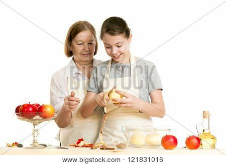 The Grandmother Teaches The Granddaughter To Cut Off A Peel From Apple