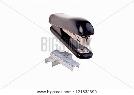 old rusty stapler whit staples on white background