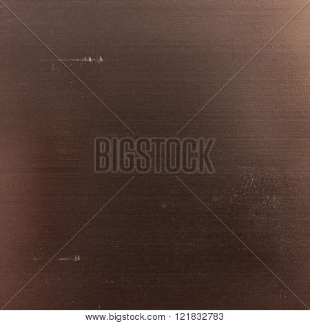 Background texture of a shiny metal sheet with a rough stippled textured surface reflecting light. Metal texture ** Note: Soft Focus at 100%, best at smaller sizes