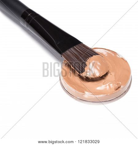 Makeup Brush With Liquid Foundation On White Background