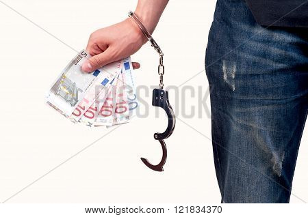 Hand with handcuffs holding money on white background