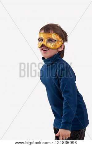 Little Boy Wearing A Gold Carnival Mask, Pretending To Be A Superhero