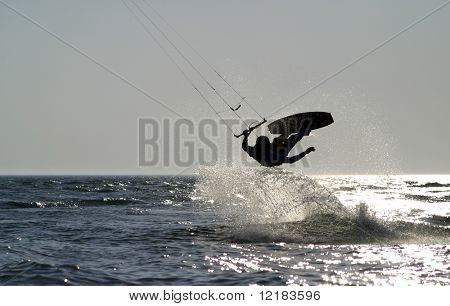 kite boarder jumping on the ocean