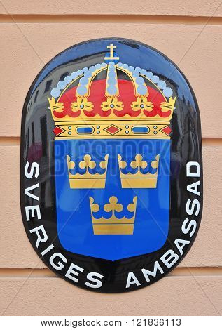 MINSK BELARUS - NOVEMBER 1: Sweden coat of arms and sign of Sweden Embassy in Minsk on November 1 2014. Sweden is a Scandinavian country in Northern Europe.