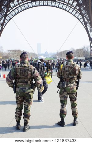 PARIS, FRANCE - March 3, 2011: Enhanced security of military forces under Eiffel tower in Paris
