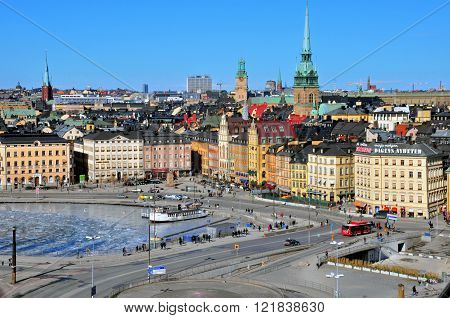 STOCKHOLM SWEDEN - MARCH 16: People on one of the largest square of Stockholm downtown on March 16 2013. Stockholm is a capital and the largest city of Sweden.