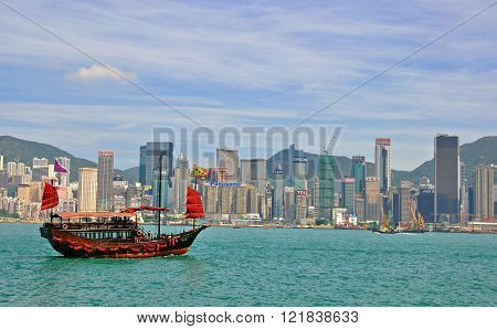 HONG KONG CHINA - JUNE 5: Chinese traditional ship and Hong Kong downtown from Kowloon Island on June 5 2012. Hong Kong is one of the two Special Administrative Regions of the People's Republic of China.