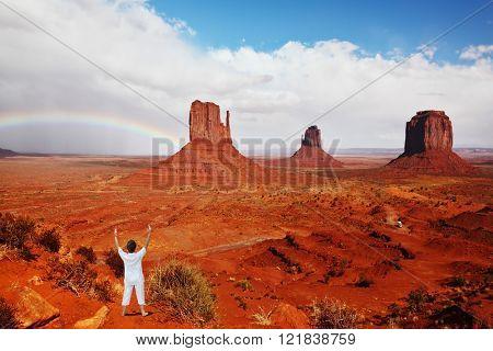 Woman in white performs asana
