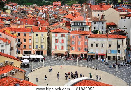 PIRAN SLOVENIA - SEPTEMBER 29: People goes by the main square of Piran city on September 29 2012. Piran is a city resort in the west of Slovenia.