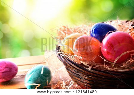 Easter Eggs On A Wooden Table In Nature Elevated View