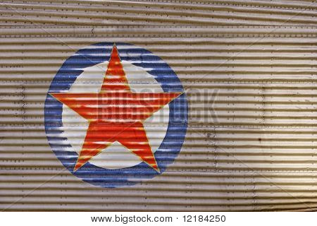 red star on side of airplane