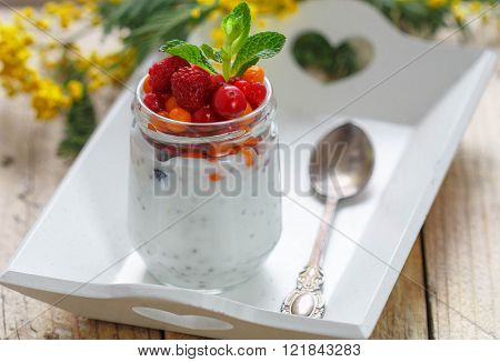 Fresh Greek yogurt with Chia seeds and fresh berries - cranberry, raspberry and sea buckthorn. Diet