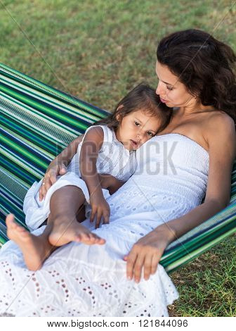 Mother and daughter are resting in the country side.