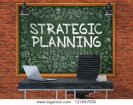Chalkboard on the Office Wall with Strategic Planning Concept.