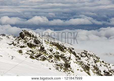 Rocky Snowy Mountain Peak Clouds