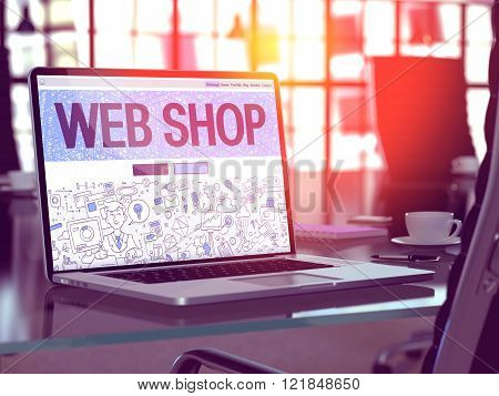 Web Shop on Laptop in Modern Workplace Background.