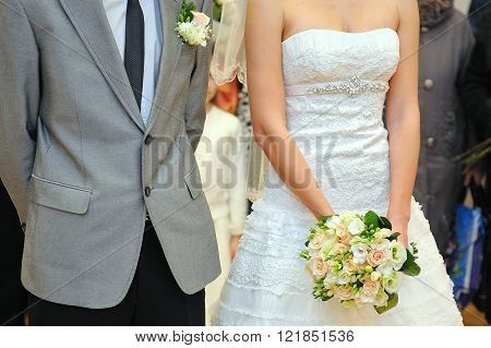 Bride and groom with bouquet in wedding day
