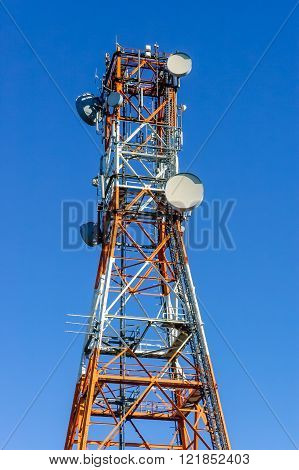 Radio/telecommunication Tower In White And Orange With Blue Sky