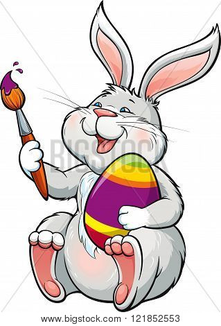 Lovely happy bunny with brush paints easter egg