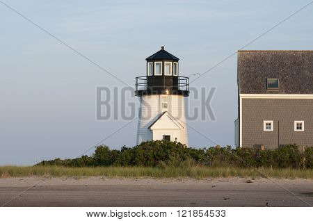 Hyannis Harbor lighthouse tower as the sun sets on a warm summer day.