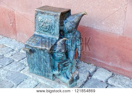 Wroclaw Poland - December 31 2015: Small bronze sculptures of gnomes. More than 250 figures are set on the streets of Wroclaw and is a symbol of the city.