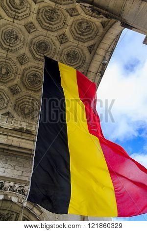 Brussels, Belgium - May 10: Belgium flag under the triumphal arch in Cinquantenaire park May 10, 2013 in Brussels, Belgium.