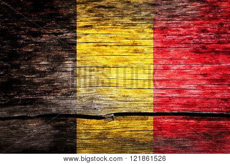 Belgium flag painted on the old cracked wood with worn-out paint. Grunge look.