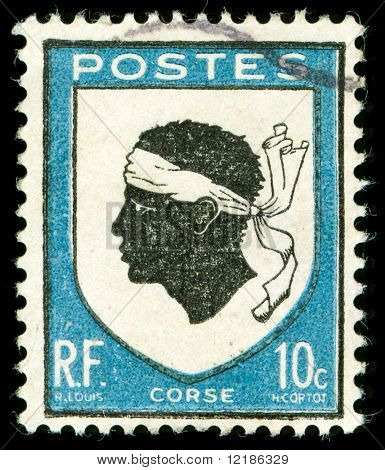 Vintage estampilla con el emblema nacional de Córcega de una cabeza morisca
