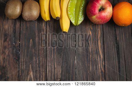 Frame Of Fresh Fruits On Wooden Background