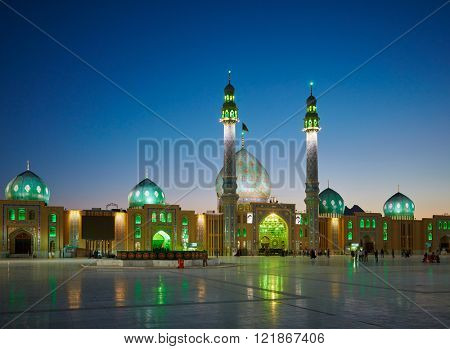 QOM, IRAN - March 09, 2016: People walking in the yard of Jamkaran mosque. Qom, Iran