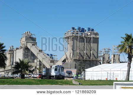 Dockside concrete plant on a rail line.