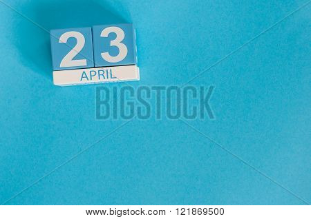April 23rd. World Book Day. Image of april 23 wooden color calendar on blue background.  Spring day,