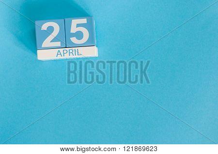 April 25th. International Day Of DNA. Image of april 25 wooden color calendar on blue background.  S