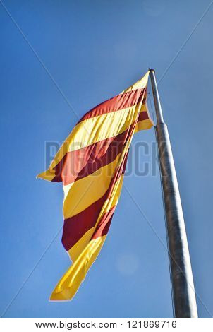 Catalan flag fluttering in the wind in Montjuic Castle