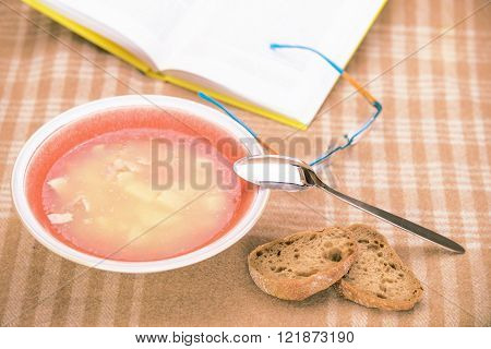 Stilllife with soup plate and book