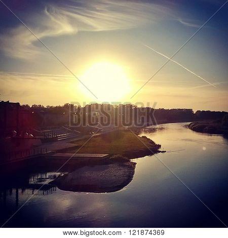 a sunset over warta river in konin, poland