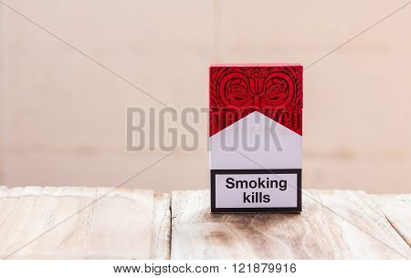 PHARE, THAILAND - MARCH 9, 2016. Pack of Marlboro Cigarettes on Wooden Table, made by Philip Morris. Marlboro is the largest selling brand of cigarettes in the world.