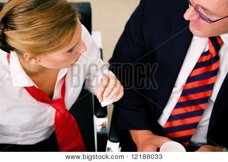 Two Business People (male / female) having a discussion